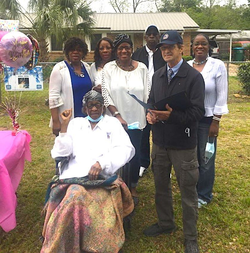 Mayor JB Whitten honors Catherine Dortch with a proclamation on her 90th birthday.