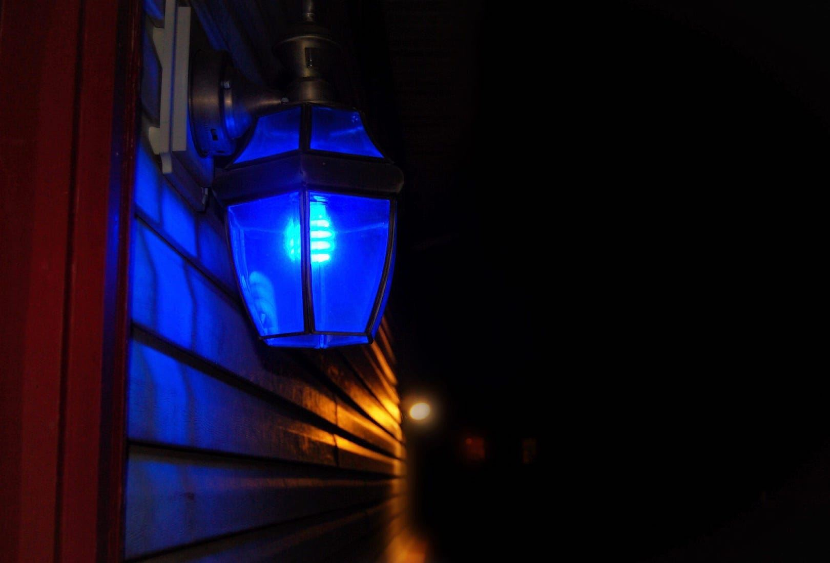 A blue porch light honors law enforcement officers during May.