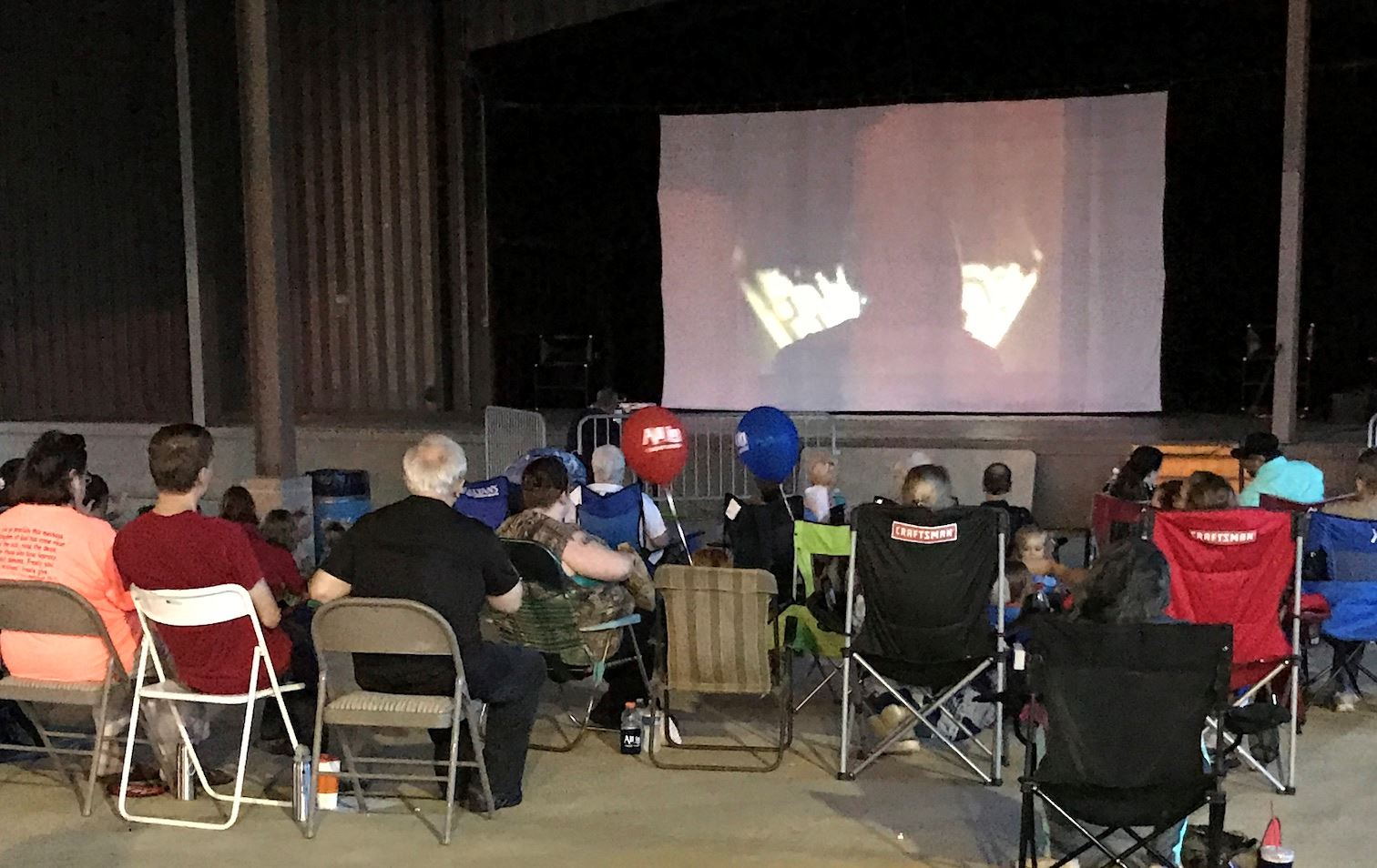 Crestview residents watch a film during a Family Movie Night in the Spanish Trail Park amphitheatre.